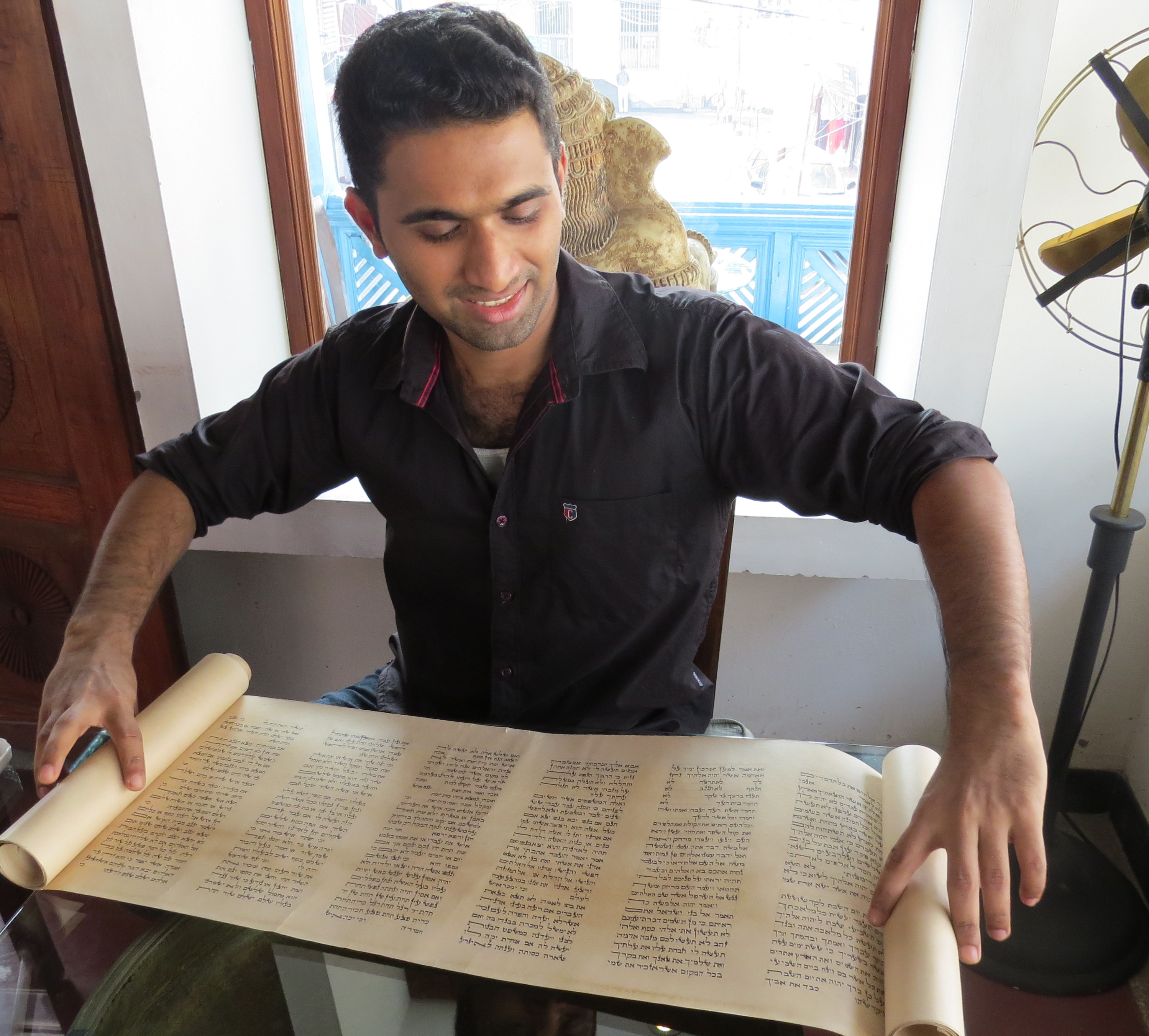 Thoufeek Zakriya with a sample of his Hebrew calligraphy  | Photo by Gabriel Weinstein