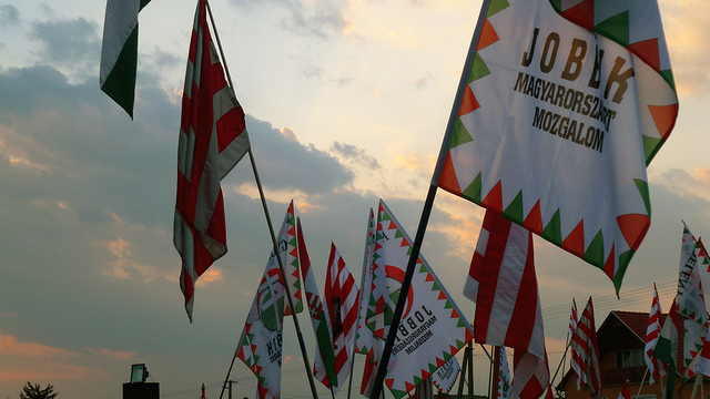 Supporters wave flags of Jobbik, an anti-Semitic Hungarian political party | CC via flickr user Leigh Phillips