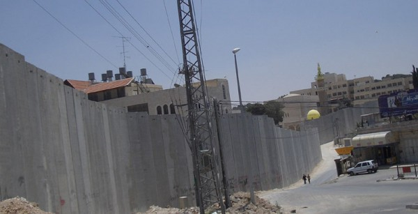 The Israeli West Bank Barrier at Abu Dis. | CC via Wikimedia Commons