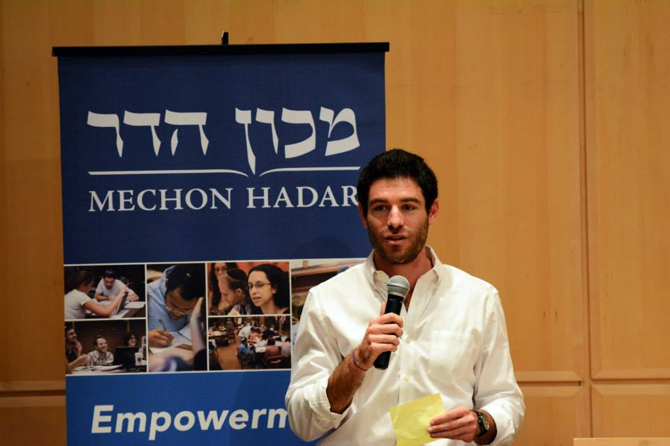 Yoav Schaefer speaking at the Symposium | via Facebook.