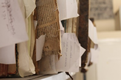 Genizah fragments sticking out on a shelf | Photo Credit: Maia Erickson