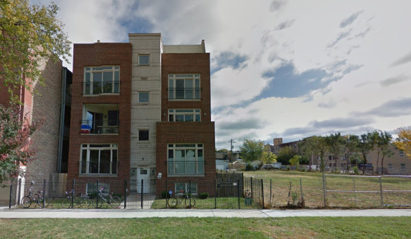 """The University of Chicago AEPi building, left, and a neighboring vacant lot referred to as """"Palestine"""" in emails between members obtained by BuzzFeed News. 