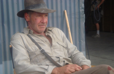 Harrison Ford on the set of Indiana Jones and the Kingdom of the Crystal Skull. | By John Griffiths, [CC BY-SA 2.0] via Wikimedia Commons